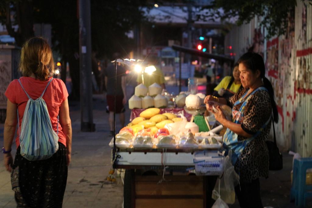 Birgit strolling past the night vendors