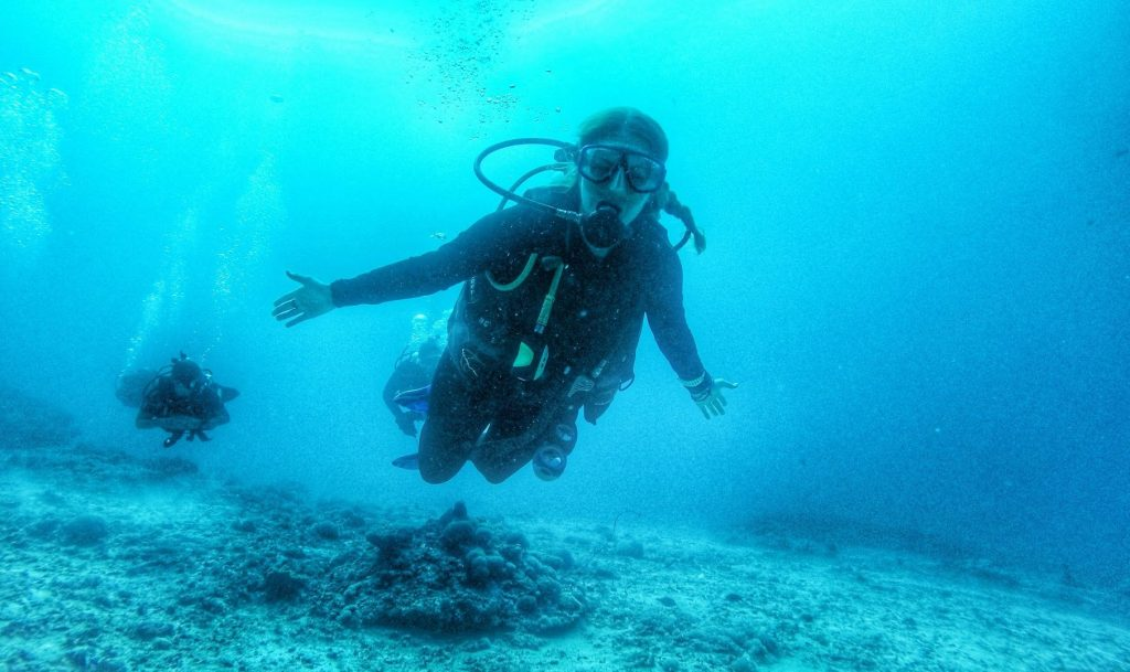 Holly diving under the sea